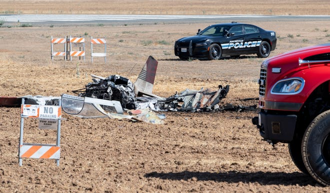 Emergency personnel investigate a plane crash at the north end of the Porterville airport on Monday, June 7, 2021. The airport is expected to be closed for the next 12 hours.