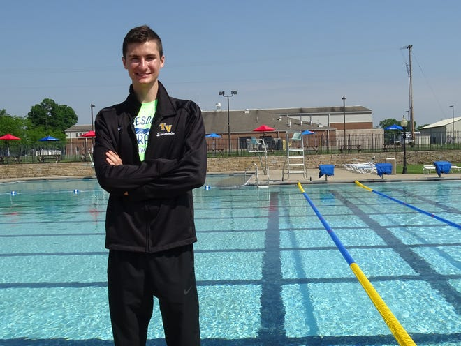 Recent Tri-Valley High School graduate Cyrus Dittmar, 18, stands in front of his home-turf pool at Dresden Swim Center. The school record-setting swimmer is an assisting coach of the Dresden Doratos, a swim team for ages 6 through 18 in its inaugural season.