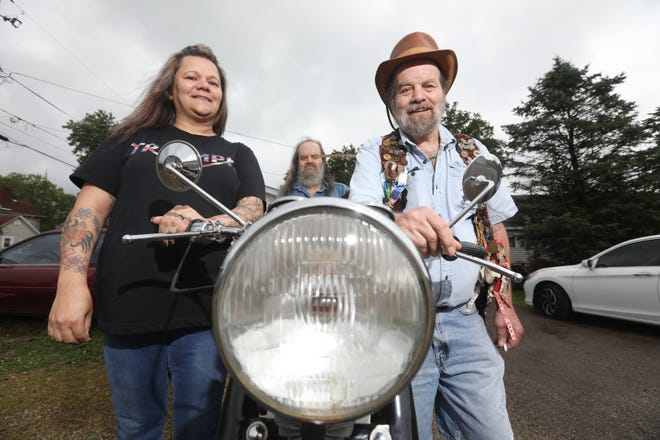 Lisa Fox, from left, James Fiore and John Fiore will host the Friends of Slow Joe British Motorcycle Show this weekend in New Lexington. Lisa is the niece of the late Joe Ellis,  a motorcycle enthusiast who lost his battle with cancer in 1986.