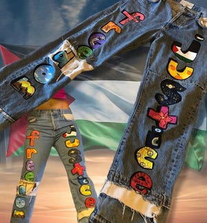 Roya Wolfe hand-painted old denim jeans to sell on her thrift page, Planet Wolfe.