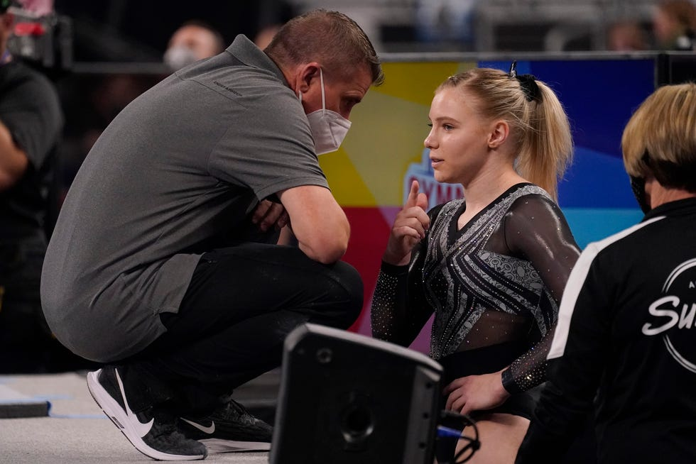 Coach Brian Carey, left, and talks with Jade Carey before her floor exercise routine during the U.S. Gymnastics Championships on June 4, 2021, in Fort Worth, Texas.