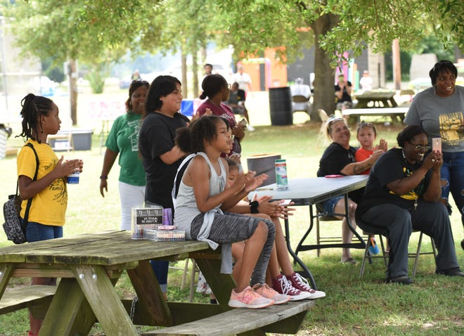 In this June 19, 2020, file photo, participants in the Smithville Juneteenth celebration at MLK Park listen to speeches by students on the meaning of Juneteenth.
