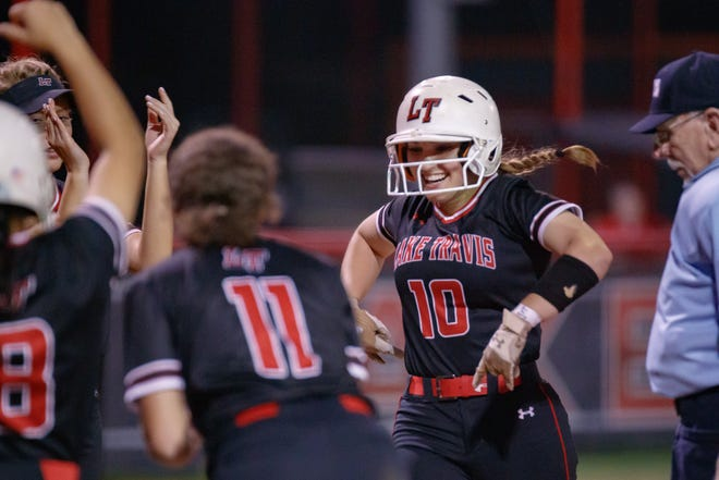 Lake Travis outfielder Emma Craver, greeted by her teammates after hitting a home run last season against Westlake, said this was her favorite high school softball memory.