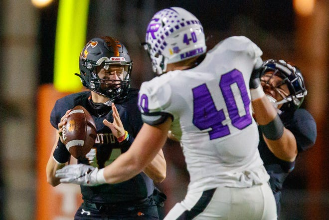 Hutto quarterback Grayson Doggett looks for a pass receiver against Cedar Ridge last season. Now in his third season as a starter, Doggett gives the Hippos themost proven quarterback in the district.