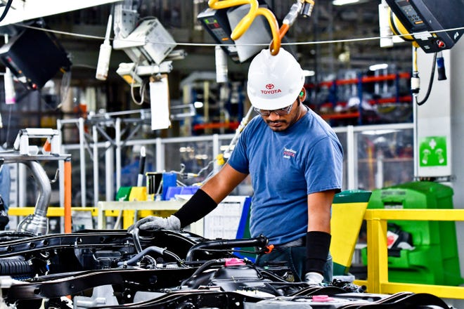 Employees work on the assembly lines at Toyota's manufacturing plant in San Antonio in this file photo. The Texas manufacturing sector picked up steam this month, despite rising costs for raw materials and a tight labor market, according to a new report from the Federal Reserve Bank of Dallas.