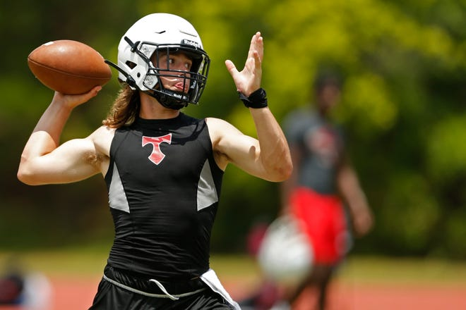 North Oconee quarterback Gavin Black looks to throw a pass during a 7-on-7 football competition hosted by Athens Academy in Athens, Ga., on Tuesday, June 8, 2021. Multiple area schools came out to compete in the competition.