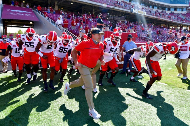 Kirby Smart and the Bulldogs head onto the field for their September 2020 game at Arkansas.