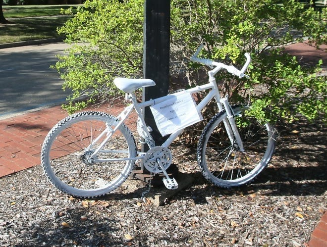 """This """"ghost bike"""" was put up by Jim Borchert an avid bicyclist, to honor of Damiyon Frazier, 15, who was killed by a motorcyclist in June 2019 while riding his bicycle on Bartges Street in Akron."""