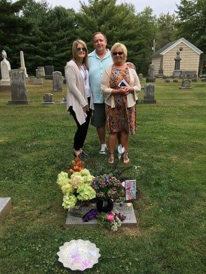 Lynne Daus stands at her daughter Jordan's gravesite with Roman Dann and his wife, Susan Dann.