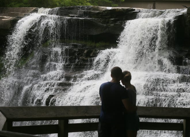 A couple takes in the view of Brandywine Falls in Cuyahoga Valley National Park on Tuesday, June 8, 2021.