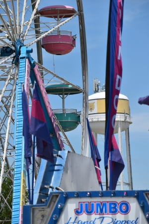 The Madill water tower stands behind a ferris wheel at the National Sand Bass Festival Tuesday, June 8, 2021. The carnival opens at 5 p.m. each day through Friday and noon on Saturday.