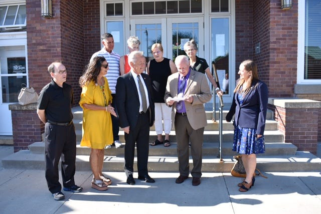 Story City officials and Mayor Mike Jensen react to the check presentation Friday, June 4, 2021 by Eric Nelson on behalf of the Fran Kinne estate.