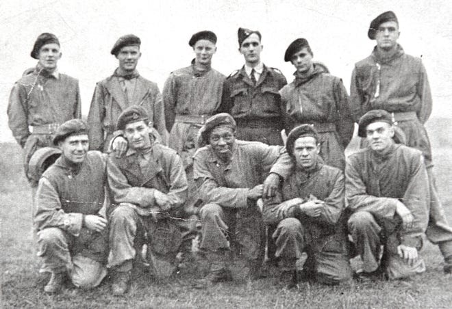 Dennis Trudeau, Grovetown's former mayor and city councilman, is a World War II veteran who participated in the D-Day invasion as a Canadian paratrooper. He will be honored by France with the Legion of Honour. Trudeau is seen here on the front row, second from left, with his unit.