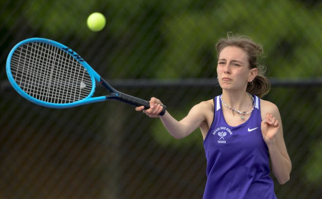 Bourne second doubles player Caroline Peddicord returns a shot in Monday's sweep of Seekonk.