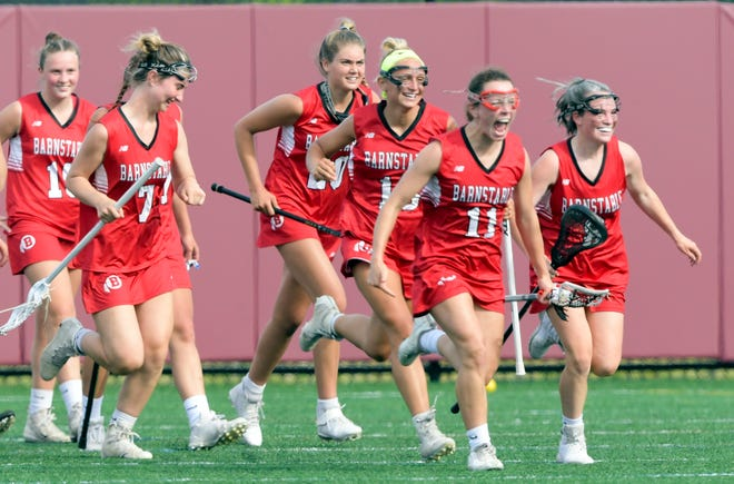 Barnstable lacrosse players celebrate after defeating Falmouth for sole possession of the Cape & Islands League Atlantic division title on Tuesday.