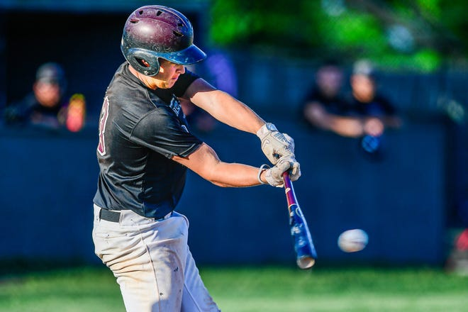 """Chillicothe (Mo;) Mudcats infielder Blake Falor tags a 2-outs, first-inning pitch for a 2-runs single against the Des Moines (Iowa) Peak Prospets at Chilllicothe's """"June"""" Shaffer Memorial Park Stadium in college-level, wood-bat summer baseball Monday, June 7, 2021. This hit gave the Mudcats a 4-0 lead, but the Iowans rallied late to prevail, 11-8."""