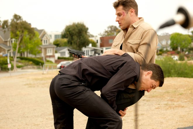 """Actors Josh Murray and Lou Ferrigno Jr. in a scene from """"Final Frequency."""""""