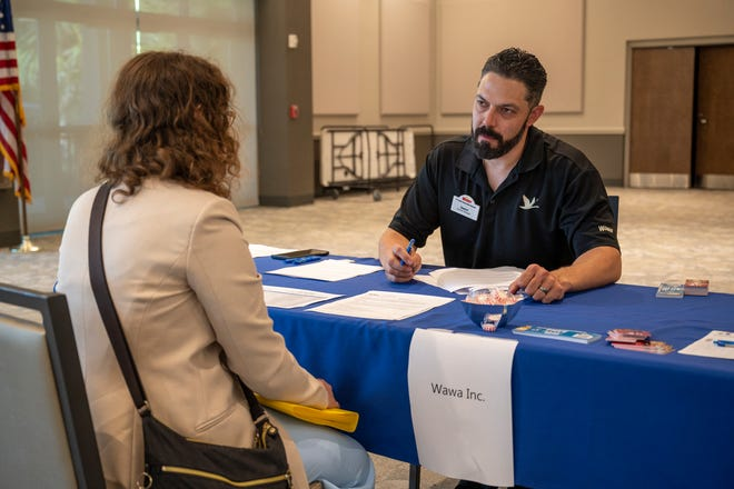 A general manager from Wawa Inc. speaks with a potential employee at the Hospitality Hiring Event at the Venetian Center on Tuesday. [Cindy Peterson/Correspondent]