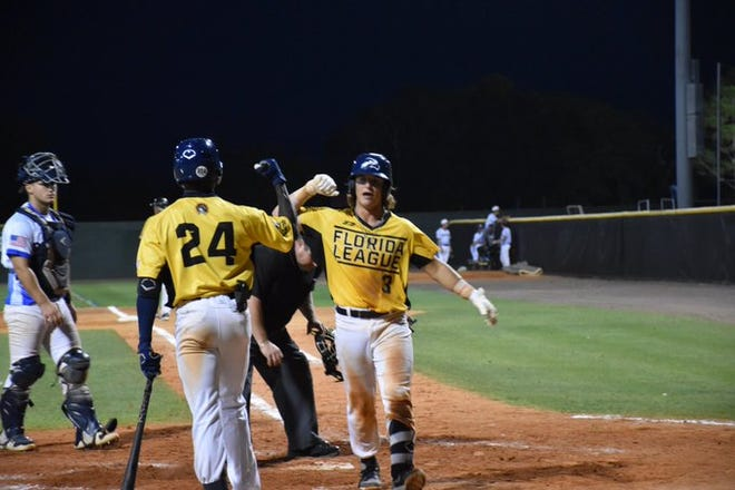 Leesburg's Travis Stapleton (right) gets congratulated after hitting a home run in Monday's game against Sanford at Sanford Memorial Stadium. The River Rats won the game 8-6. [COURTESY / LEESBURG LIGHTNING]