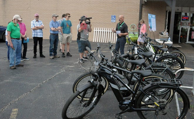 Bill Buckwalter, owner of Ride-On in Wooster talks Tuesday to a group about the E-bikes.