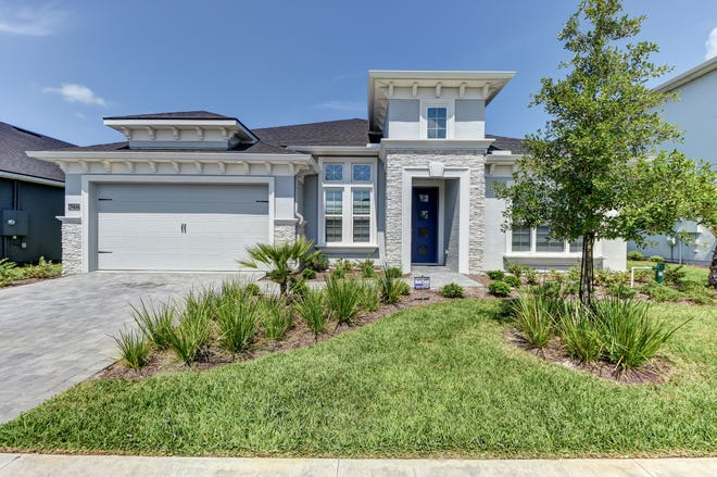 Experience a remarkable cool, calm feeling when you enter this customized pool home in Port Orange's gated community of Spruce Meadow at Woodhaven.