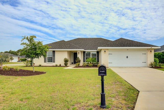 This pristine brick home in like-new condition sits on a beautiful quarter-acre corner lot in Flagler Beach.