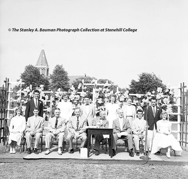 In this June 9, 1953, file photo, platform guests at Brockton High School's graduation included,in the front row, Class of 1953 Vice President Karen E. MacDonald; class oratorGeorge P. Reservitz; high school masterAlton E. Johngren; Superintendent of Schools Edwin A. Nelson; headmasterRalph S. Frellick; class PresidentJoseph S. Carnabuci; class poetMarie Melideo; and, in the back row, sophomore class PresidentJames S. Gurney; Dramatic Club gift presenterMarilyn Ann Tarasiewicz; winner of the Rensselaer Medal for proficiency in mathematics and scienceLewis Peter Gold; library monitors' gift presenter Ruth Ann Cowan; dean of girlsBernice Sylvester; and junior class PresidentFlaviano S. DiFalco.