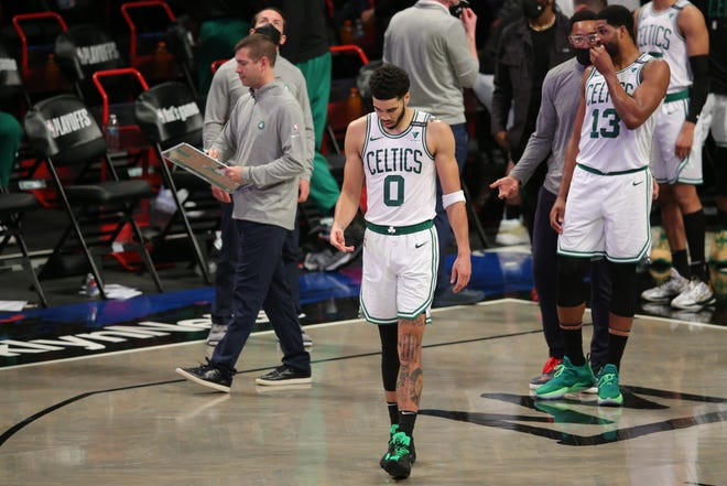 Jun 1, 2021; Brooklyn, New York, USA; Boston Celtics small forward Jayson Tatum (0) reacts during a timeout late during the fourth quarter of game five of the first round of the 2021 NBA Playoffs against the Brooklyn Nets at Barclays Center.
