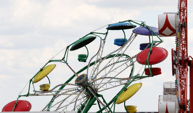 The Paratrooper, one of the carnival rides provided by Boden Amusements, is shown Tuesday next to Memorial Auditorium. Workers were setting up the carnival, which starts Wednesday in conjunction with Burlington Riverfront Entertainment's Summer Concert Series that kicks off Thursday and runs through Saturday.