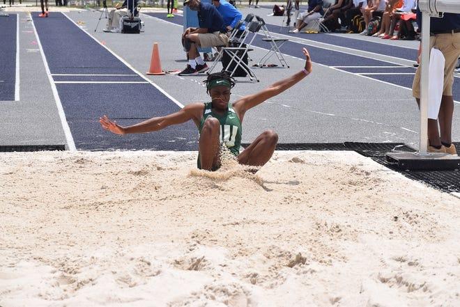 Jacksonville University's Adja Sackor lands during the women's triple jump at the University of North Florida's Hodges Stadium. [JU Athletics]