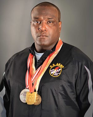 Dremiel Byers with medals earned during his time with USA Wrestling.
