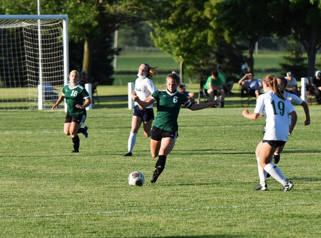 Geneseo senior Taylor DeSplinter, No. 6, in action in the recent Sectional Title game when Geneseo faced Peoria Notre Dame at Geneseo. Elle Whiteman, No.18, also a senior, is visible in back to the left.