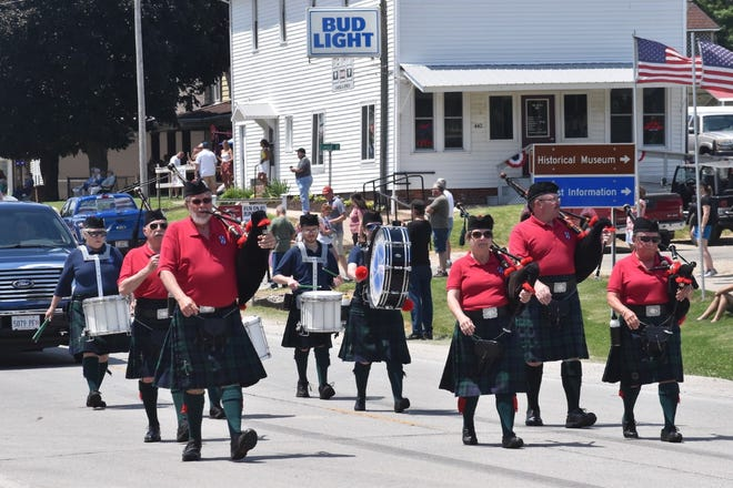 Black Hawk Pipes and Drums of the Quad Cities marches on Illinois 81 on Saturday, June 5, during the grand parade of the Andover 185th + 1 Anniversary celebration. The band lost one of its members, bagpiper Roger Stancliff of Andover, to COVID-19 last fall