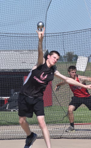 Orion's Nick Shillington competes in the shot put at the boys-only meet on Wednesday, May 26, at Charger Field.