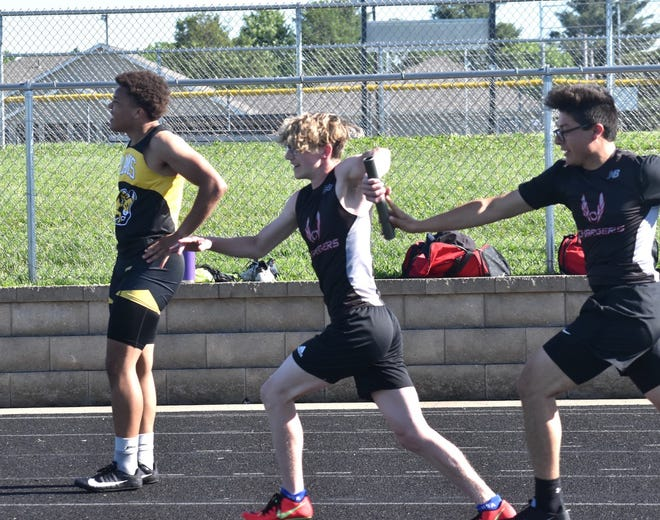 Orion's Luciano Bradley, center, takes the baton from Nathan Monzon for the anchor leg of the 400-relay on Wednesday, May 26, at Charger Field during a boys-only meet.