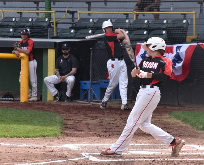 Orion's Kile Johnson takes a big swing in the Clinton LumberKings' stadium, NelsonCorp Field, in Clinton, Iowa, on Thursday, May 20. The Chargers played a Three Rivers West game with the Morrison Mustangs.