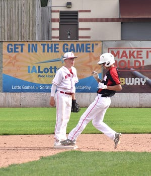 Orion's Jarrett Thornburg, right, steals second in the top of the third inning on Thursday, May 20, when the Chargers played the Morrison Mustangs at NelsonCorp Field, the home of the Clinton LumberKings in Iowa.