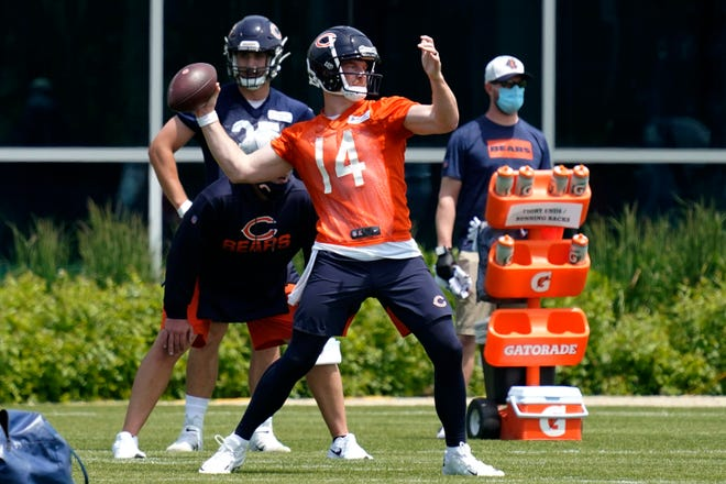 Chicago Bears quarterback Andy Dalton looks to pass during a practice in Lake Forest on Wednesday, June 2, 2021.