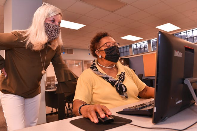 Ann Angermeier, executive director of Upstate Workforce Board, left, helps Deborah Rogers, right, with her job search at SC Works in Spartanburg, Tuesday, June 8, 2021. Rogers had retired after 40 years as an educator but had gone back to work and lost her job last year during the pandemic.
