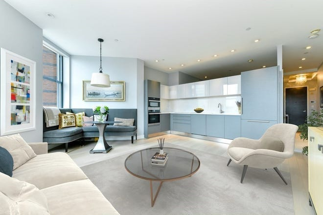 Furniture placement in the open living room is easy given the size (as in big) of the well-proportioned space.