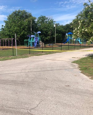 """Crime scene taped blocked off Gordon Heights Park near Bartow Tuesday morning where a 17-year-old was shot and killed in what Polk County Sheriff Grady Judd called """"an ambush."""""""