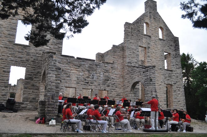 In this file photo, the Lake Area Community Orchestra performs in front of the castle at Ha Ha Tonka State Park.