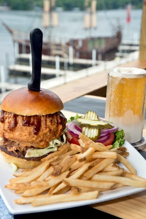 The Carolina from Jolly Rogers is made up of pulled pork, jalapeno, coleslaw, an onion ring and drizzled with BBQ sauce.