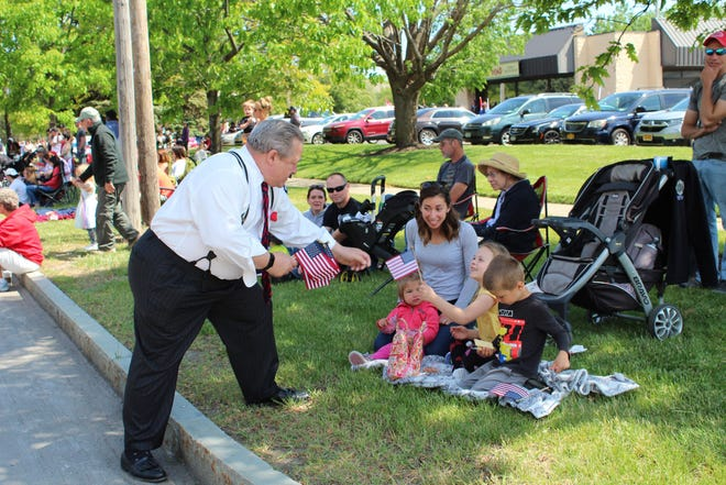 Supervisor Bill Reilich greets local residents during the town of Greece Memorial Day Parade.