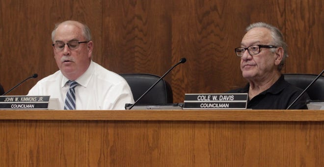 Moberly Mayor Jerry Jeffrey, left, and councilman John Kimmons, right, listen to a report being shared Monday, June 7 during a city council business meeting held at City Hall.