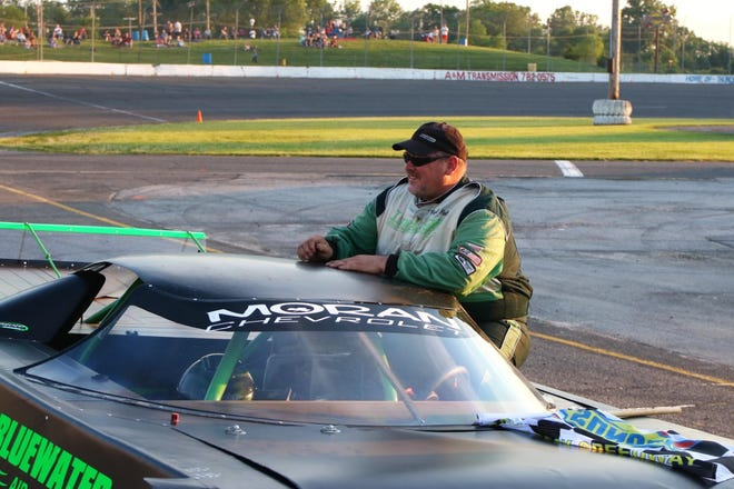 Paul Pelletier of New Boston climbs out of his car after winning the Outlaw Super Late Model feature race at Flat Rock Speedway on his birthday Saturday night.