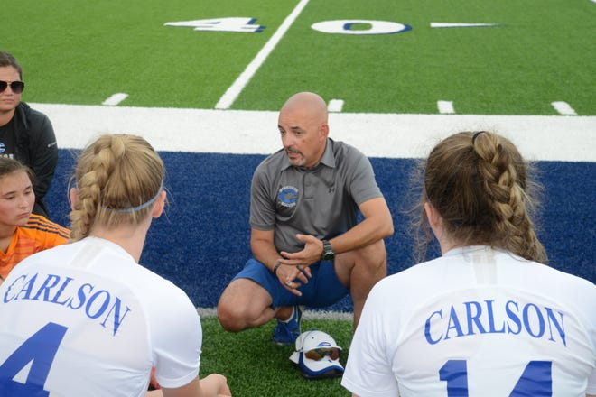 Gibraltar Carlson girls soccer coach Steve Briggs talks to his team at halftime of a 5-0 loss to Dearborn Divine Child in the semifinals of the Division 2 Regional at Trenton Tuesday.