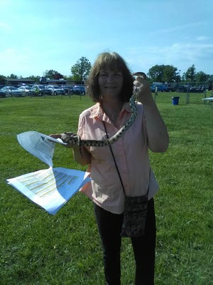 Jan Linenfelser, an Airport High School aide, captured this 4-foot snake during commencement ceremonies.