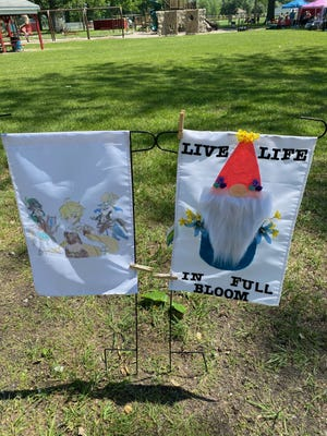 Two other winning flags made by Gracie Skyles, 15, and Terri Lindenmuth, were displayed during the Carleton Farmers Market Saturday at Ash-Carleton Park. Skyles won the teen prize and Lindenmuth won the adult prize.