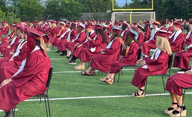Members of the graduating class were spread out on the new Alumni Field at Millbury Memorial Junior/Senior High School on June 4, 2021.